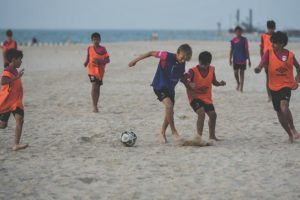 Dubai beach football kids